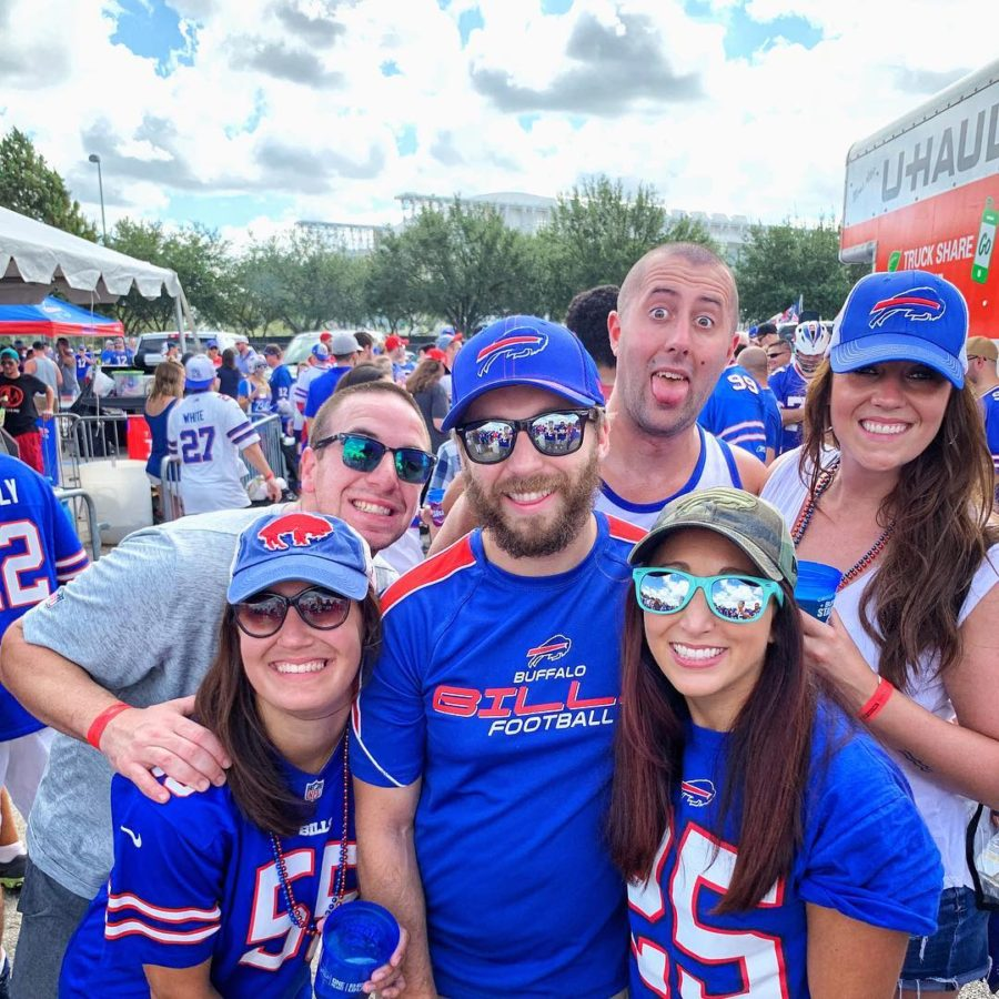 Group of friends posing with buffalo Bills apparel