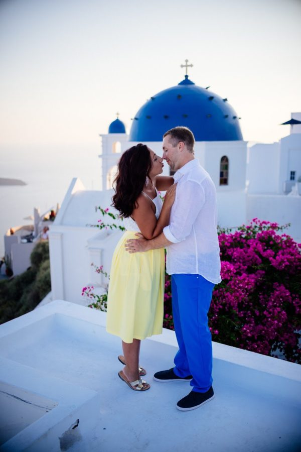 Santorini Flowers and dome with boy and girl kissing in front