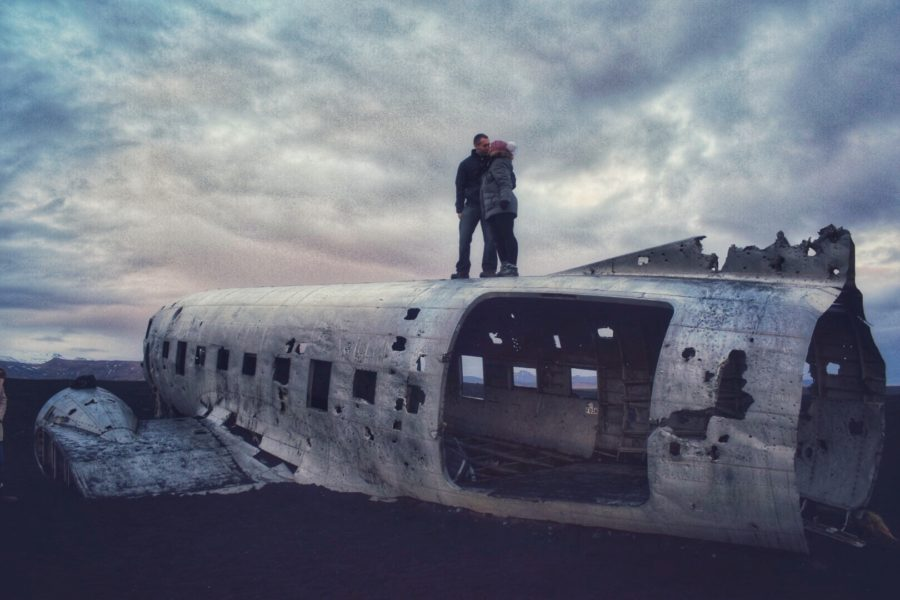 Couple standing on top of Solheimasandur Plane Wreck in Iceland