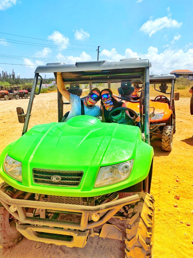 Couple driving bright green UTV