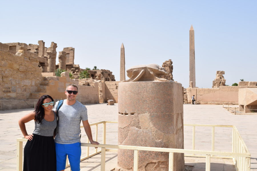 Boy and girl posing in front of Scarab Beetle Statue