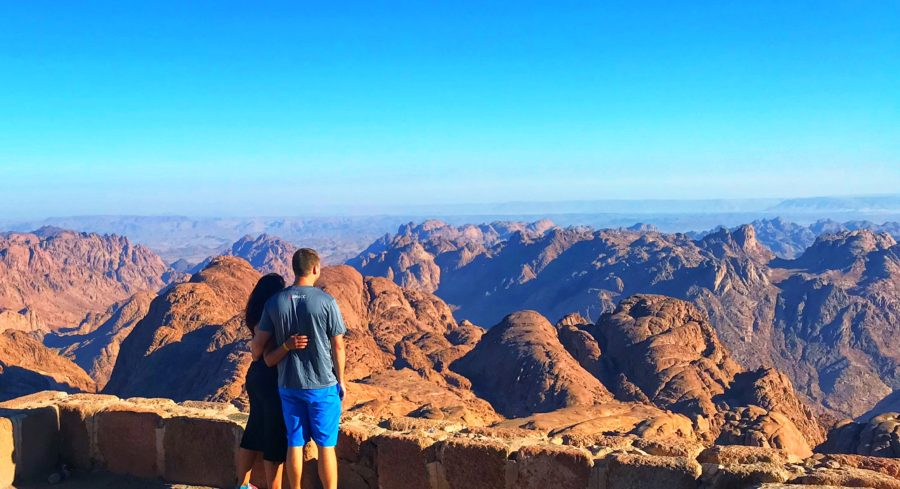 Boy and girl arm & arm in front of Mt Sinai