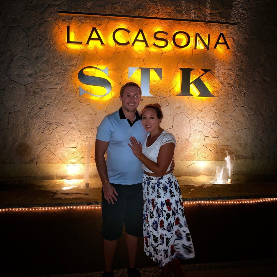 boy and girl posing in front of La Casana STK sign