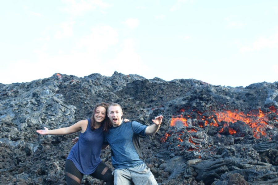 Boy and Girl posing in front of Lava flowing