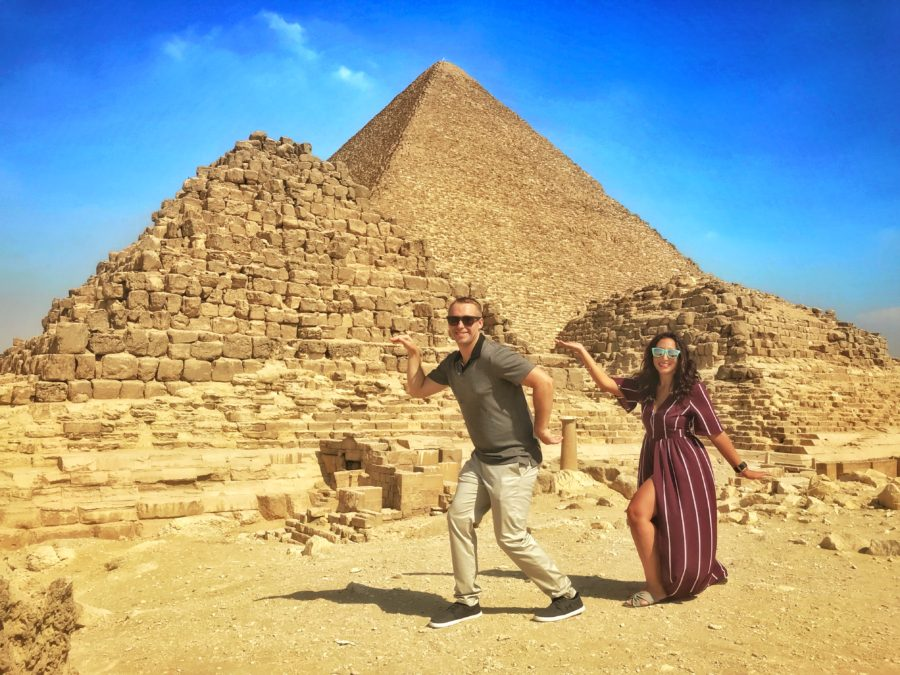 Boy and girl walking like an Egyptian in front of Pyramid