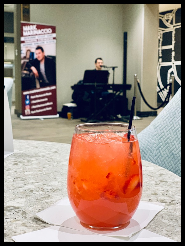 Pink cocktail with Mark Marinaccio singing in the background