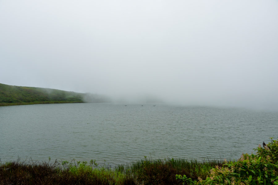 El Junco Lagoon with fog covering it