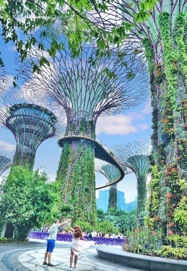 Couple dancing in front of tall trees in Gardens by the Bay