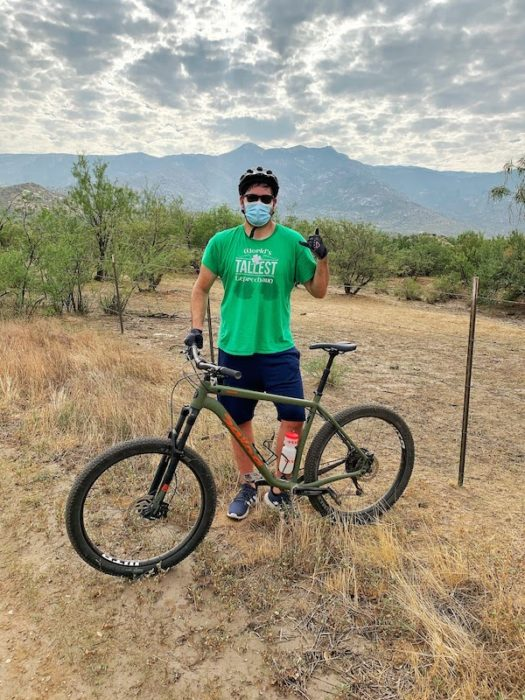 Man mountain with mountain bike and Catalina mountains in background