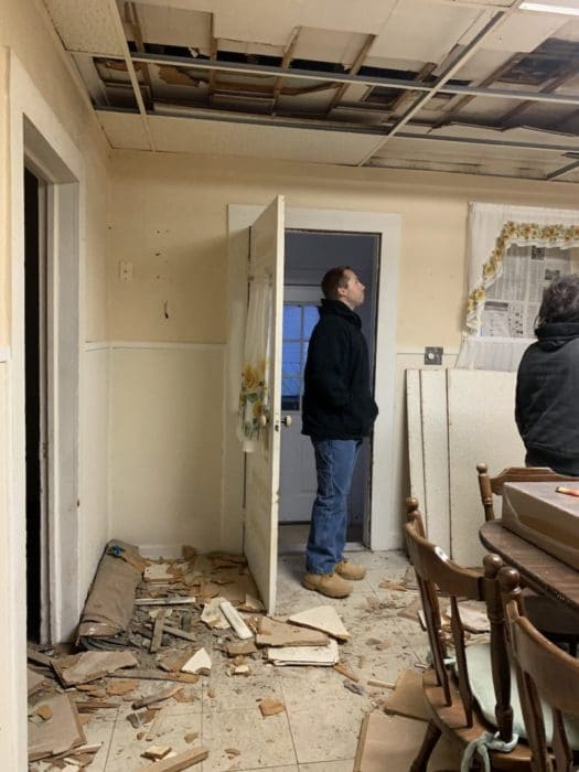 Guy looking at house torn apart for investment property renovations