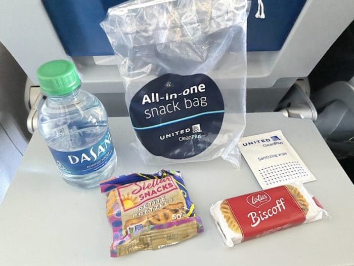 United's All in One snack bag with water, pretzels, Biscoff cookies, and sanitizer wipes.