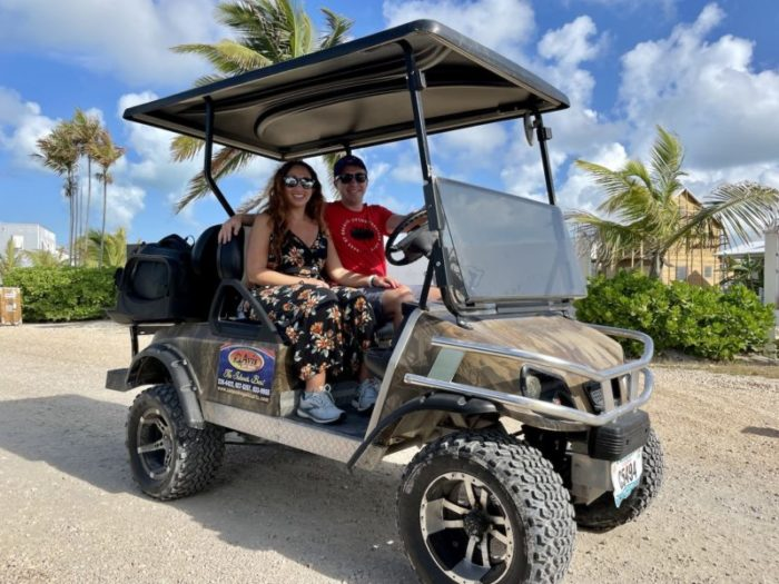 Man and woman sitting on a golf cart