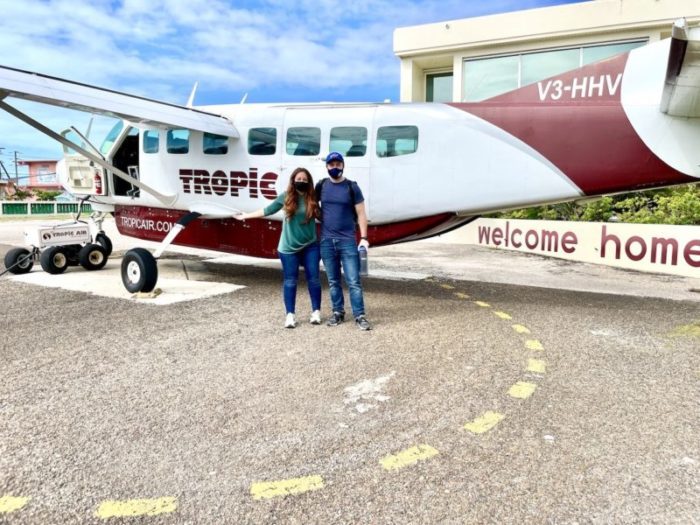 Couple standing in front of Tropic Airplane
