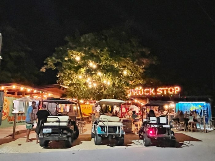 The Truck Stop with 3 golf carts outside
