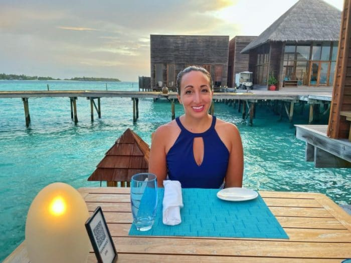 Woman at dinner surrounded by water