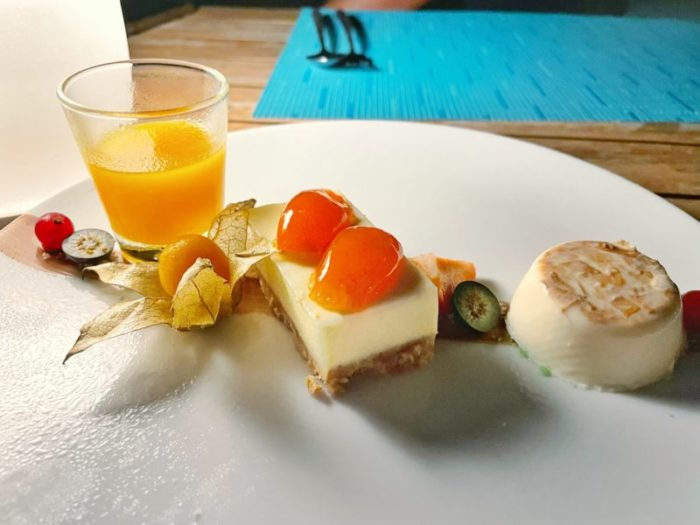 Cheesecake desert with panna cotta, orange confit and fruit soup